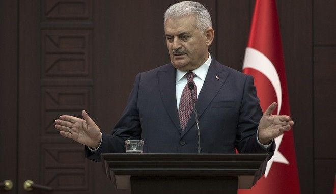 Turkey's Prime Minister Binali Yildirim, gestures as he talks during a joint news conference with British Prime Minister Theresa May, following their meeting in Ankara,Turkey, Saturday, Jan. 28, 2017. During the news conference, Yildirim strongly criticised U.S. President Donald Trump's move to suspend admission of refugees, saying 'you cannot settle this issue by building walls'. Yildirim says only global cooperation can end the refugee crisis, adding 'nobody leaves their homes for nothing'. May said: 'The United States is responsible for the United States' policy on refugees'. (Prime Minister's Press Service, Pool photo via AP)