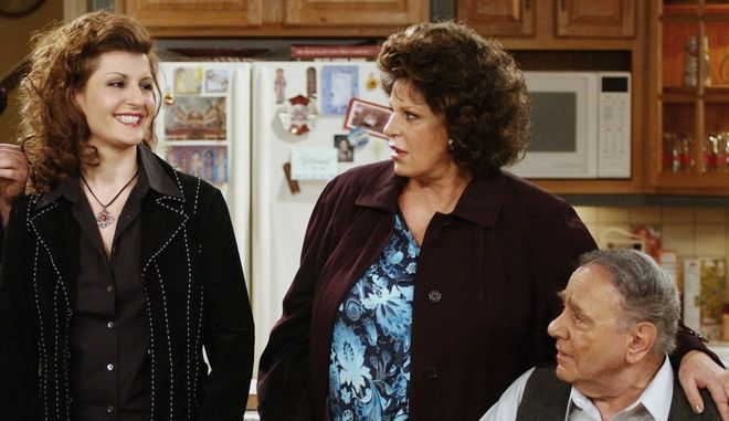 """Cast members of the new CBS comedy series """"My Big Fat Greek Life,"""" from left, Louis Mandylor, Nia Vardalos, Lainie Kazan and Michael Constantine, rehearse a scene on the set of the show Friday, Feb. 14, 2003, in Los Angeles. The half-hour sitcom, based on the hit film """"My Big Fat Greek Wedding,"""" will settle into a regular Sunday night time slot after it's premiere at 9:30 p.m., EST, Monday, Feb. 24. (AP Photo/Rene Macura)"""