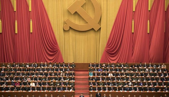 """Chinese President Xi Jinping, center, presides over the opening ceremony of the 19th Party Congress held at the Great Hall of the People in Beijing Wednesday, Oct. 18, 2017. Xi on Wednesday urged a reinvigorated Communist Party to take on a more forceful role in society and economic development to better address """"grim"""" challenges facing the country as he opened a twice-a-decade national congress. (AP Photo/Ng Han Guan)"""