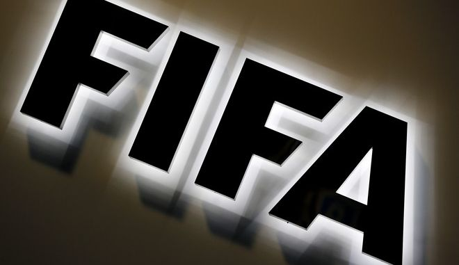 FILE - The Sept. 25, 2015 file photo shows the FIFA logo outside FIFA headquarters in Zurich, Switzerland.  FIFA announced Thursday, March 17, 2016 a  US$ 122 million loss in 2015, a year marked by corruption scandal (AP Photo/Michael Probst, file)