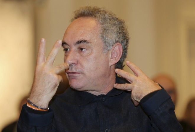Spanish chef Ferran Adria' gestures prior to the start of a press conference for the official presentation of