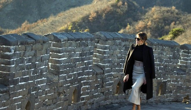 U.S. first lady Melania Trump walks along the Mutianyu Great Wall section in Beijing Friday, Nov. 10, 2017. Mrs. Trump toured Chinas famed Great Wall at Mutianyu, where she rode a cable car to a watchtower, signed a guestbook and strolled along a stretch of the wall for about half an hour with a small group of aides and security officers. (AP Photo/Ng Han Guan)