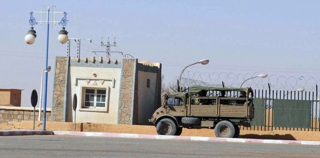 An Algerian army truck is seen in a street of Ain Amenas, near the gas plant where hostages have been kidnapped by Islamic militants, Saturday, Jan. 19, 2013. Algeria's special forces stormed the natural gas complex in the middle of the Sahara desert in a final assault Saturday, killing 11 militants, but not before they in turn killed seven hostages, the state news agency reported.(AP Photo/Anis Belghoul)