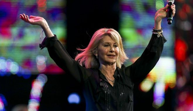 Olivia Newton John performs during the Viña del Mar International Song Festival at the Quinta Vergara in Viña del Mar, Chile, Thursday, Feb. 23, 2017. Believed to be one of the largest musical events in Latin America, the annual five-day festival was inaugurated in 1960. (AP Photo/Esteban Felix)