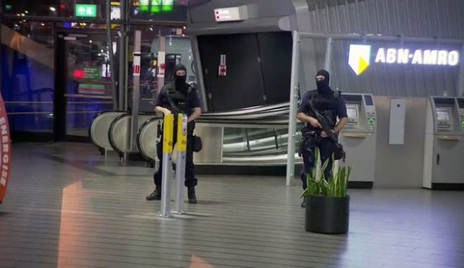 "This image made from a video from RTL shows police at Schiphol Airport in Amsterdam, Tuesday, April 12, 2016. Military police have arrested a man and are conducting an investigation at the airport after a report of a ""suspicious situation."" (RTL via AP) NETHERLANDS OUT; LUXEMBOURG OUT"