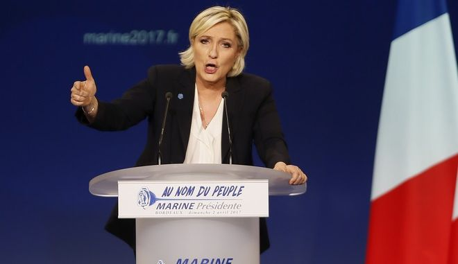 Far-right candidate for the presidential election Marine Le Pen delivers a speech during a meeting in Bordeaux, southwestern France, Sunday, April 2, 2017. Polls suggest that Le Pen and independent centrist Emmanuel Macron are the two top contenders in the election. The top two vote-getters on April 23 will compete in a presidential runoff on May 7. (AP Photo/Bob Edme)