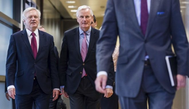 EU Chief Brexit Negotiator Michel Barnier, center, and British Secretary of State David Davis, left, walk together as they arrive at EU headquarters in Brussels on Monday, June 19, 2017. Brexit negotiators will discuss Monday Britain's financial obligations to the European Union as the long, complicated and potentially perilous process of the U.K. leaving the bloc finally gets underway. (AP Photo/Geert Vanden Wijngaert)