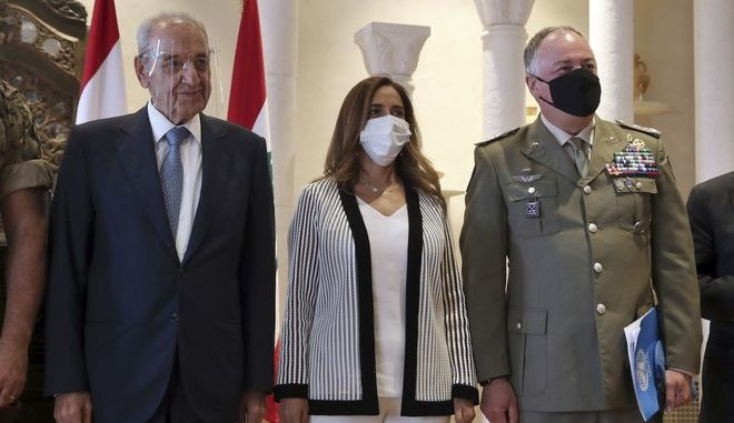 Lebanese Parliament Speaker Nabih Berri, left, the Head of Mission and Force Commander of the United Nations Interim Force in Lebanon (UNIFIL), Major-General Stefano Del Col from Italy, right, and Lebanese outgoing Defense Minister Zeina Akar, center, pose for a picture during a news conference, in Beirut, Lebanon, Thursday, Oct. 1, 2020. Berri announced Thursday that an agreement has been reached on a framework of indirect talks between Lebanon and Israel over the longstanding disputed maritime border between the two countries. (AP Photo / Bilal Hussein)