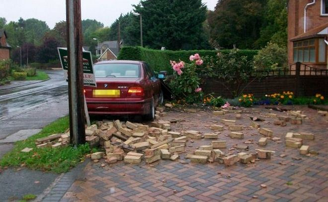 The first car to crash into the home of Tom Wardle in Bretforton, Evesham on the 29th September, 2010.. See Newsteam story NTICRASH: A man is at his witsí end after seeing a sixth car crash into his front garden in just over two-and-a-half years. Tom Wardle, of Bretforton, near Evesham, is sick and tired of the carnage caused by cars careering off the road and smashing through a stone wall at the edge of his property on Main Street. As well as the regular repair bills, Mr Wardle said he is now unable to sell his house and is worried that someone could be killed if the accidents continue.
