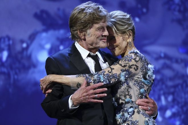 Actors Robert Redford, left, and Jane Fonda embrace onstage prior to accepting their Lifetime Achievement Awards during the 74th edition of the Venice Film Festival in Venice, Italy, Friday, Sept. 1, 2017. (Photo by Joel Ryan/Invision/AP)