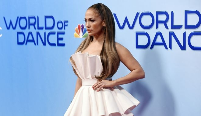 """Jennifer Lopez, a cast member on the NBC dance competition series """"World of Dance,"""" poses for photographers on Tuesday, Jan. 30, 2018, in Universal City, Calif. (Photo by Chris Pizzello/Invision/AP)"""