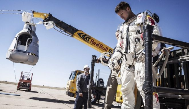 Pilot Felix Baumgartner of Austria leaves his capsule after his mission was aborted due to high winds in Roswell, New Mexico, in this October 9, 2012 handout photo. The Austrian daredevil called off his death-defying skydive from a balloon 23 miles (37 km) over the New Mexico desert on Tuesday because of winds at the launch site. REUETRS/Balazs Gardi/Red Bull Content Pool/Handout  (UNITED STATES - Tags: SCIENCE TECHNOLOGY TRANSPORT SPORT SOCIETY TPX IMAGES OF THE DAY) NO SALES. NO ARCHIVES. FOR EDITORIAL USE ONLY. NOT FOR SALE FOR MARKETING OR ADVERTISING CAMPAIGNS. THIS IMAGE HAS BEEN SUPPLIED BY A THIRD PARTY. IT IS DISTRIBUTED, EXACTLY AS RECEIVED BY REUTERS, AS A SERVICE TO CLIENTS ORG XMIT: TOR602