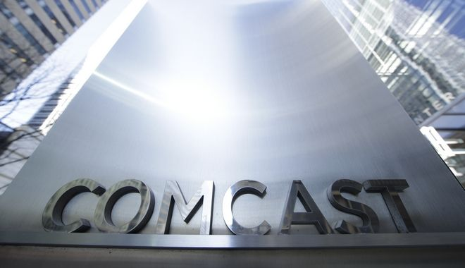 This March 29, 2017, photo shows a sign outside the Comcast Center in Philadelphia. Comcast will start selling cellphone plans called Xfinity Mobile in the coming months, using a network its leasing from Verizon. Many subscribers will save money, especially if they dont use a lot of data. The catch: Only Comcast internet customers can sign up. (AP Photo/Matt Rourke)