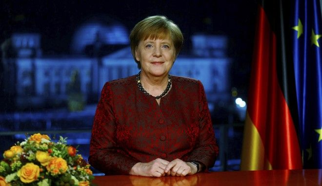 ATTENTION: EMBARGOED FOR PUBLICATION UNTIL 30 DECEMBER 11:00 PM GMT - German acting Chancellor Angela Merkel poses for photographs after the television recording of her annual New Year's speech at the Chancellery in Berlin, Germany, Dec. 30, 2017. (Hannibal Hanschke/Pool Photo via AP)