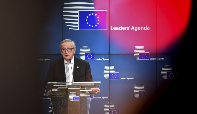 European Commission President Jean-Claude Juncker speaks during a media conference at the end of an EU summit at the Europa building in Brussels on Friday, Feb. 23, 2018. European Union leaders met without Britain Friday looking to plug a major budget hole after Brexit and endorse a plan to streamline the European Parliament by sharing out the country's seats. (AP Photo/Geert Vanden Wijngaert)