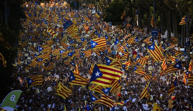 """People wave """"estelada"""" flags, that symbolize Catalonia's independence, during a demonstration calling for the independence of Catalonia, in Barcelona, Spain, Sunday, Sept. 11, 2016. The leader of Spain's powerful northeastern region of Catalonia has said he plans to propose a government-approved binding independence referendum to secede from Spain by next year. Catalonia's separatist leader, Carles Puigdemont, spoke Saturday at a news conference before celebrations of the Catalan National Day holiday, which separatists have used for years to rally hundreds of thousands in support of a new European nation. (AP Photo/Emilio Morenatti)"""