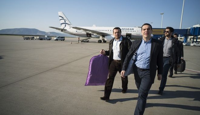 Greek government members on airplane from Athens to Bruxelles on March 19, 2015. /               19  2015.
