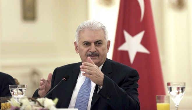 """Turkey's Prime Minister Binali Yildirim speaks to a group of foreign journalists in Ankara, Turkey, Thursday, March 9, 2017. Yildirim said  a state of emergency that was imposed following the failed coup attempt in July will be extended """"for a bit longer.""""(AP Photo/Burhan Ozbilici)"""