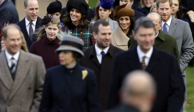 From left in background, Prince William, Kate, Duchess of Cambridge, Meghan Markle and Prince Harry arrive to attend their traditional Christmas Day church service, at St. Mary Magdalene Church in Sandringham, England, Monday, Dec. 25, 2017. (AP Photo/Alastair Grant)