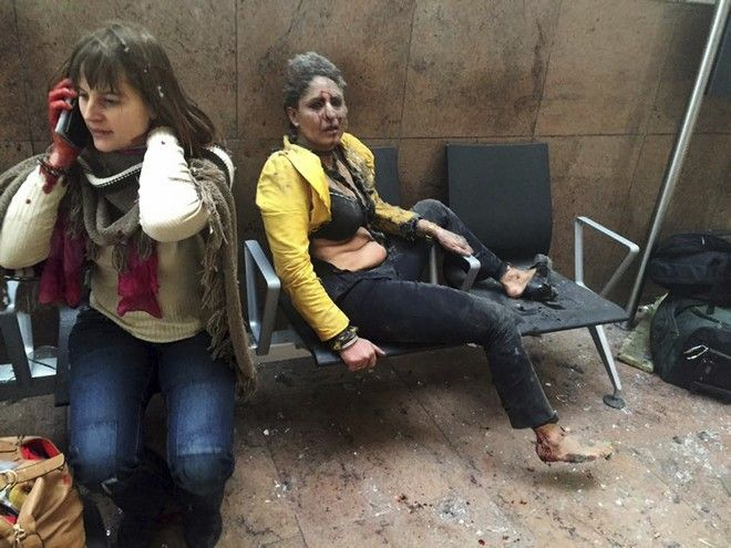 2016 AP YEAR END PHOTOS - In this photo provided by Georgian Public Broadcaster and photographed by Ketevan Kardava, Nidhi Chaphekar, a 40-year-old Jet Airways flight attendant from Mumbai, right, and another unidentified woman are shown after being wounded in Brussels Airport in Brussels, Belgium, after explosions rocked the airport on March 22, 2016. (Ketevan Kardava/Georgian Public Broadcaster via AP, File)
