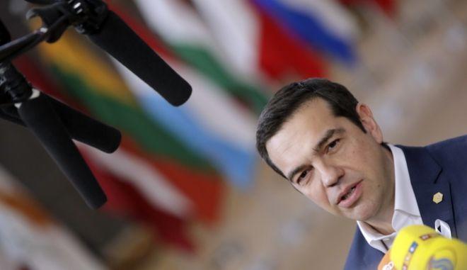 Ο Έλληνας πρωθυπουργός Αλέξης Τσίπρας προσερχόμενος στη Σύνοδο Κορυφής των '27' - 23 Μαρτίου 2018 AP Photo/Olivier Matthys)