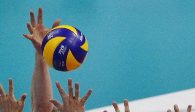 Belgium's Sam Deroo attempts to spike the ball during the 2017 Volleyball European Championship third place match between Belgium and Serbia in Krakow, Poland, Sunday, Sept. 3, 2017. (AP Photo/Czarek Sokolowski)