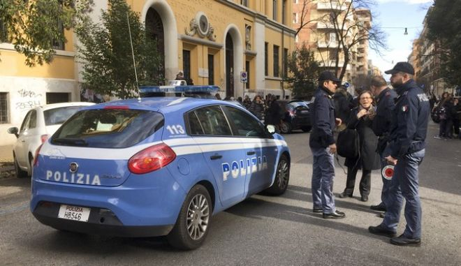 Italian police stand by an evacuated school after three earthquakes hit central Italy in the space of an hour, shaking the same region that suffered a series of deadly quakes last year, in Rome, Wednesday, Jan. 18, 2017. (AP Photo/Paolo Santalucia)