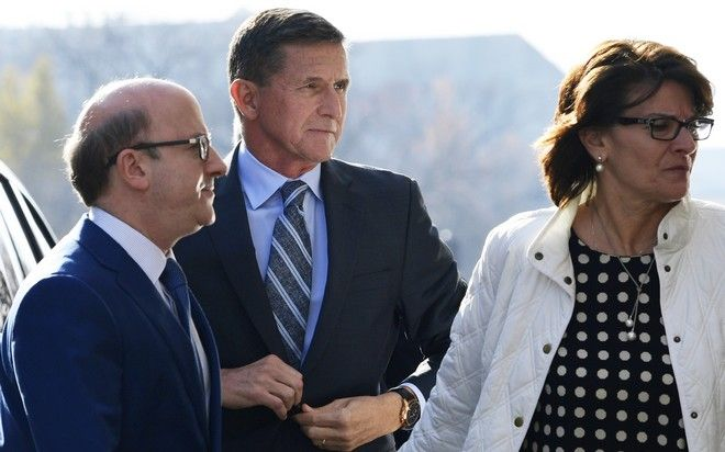 Former Trump national security adviser Michael Flynn arrives at federal court in Washington, Friday, Dec. 1, 2017.  Flynn is to plead guilty Friday to making false statements to the FBI, the first plea by any of the four former Trump advisers charged so far in a wide-ranging investigation led by special counsel Robert Mueller.   (AP Photo/Susan Walsh)