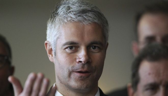 "Laurent Wauquiez, who campaigns to become the new head of the conservative ""Les Republicains"" party, is pictured during a meeting in Bayonne, southwestern France, Saturday, Nov.25, 2017. (AP Photo/Bob Edme)"