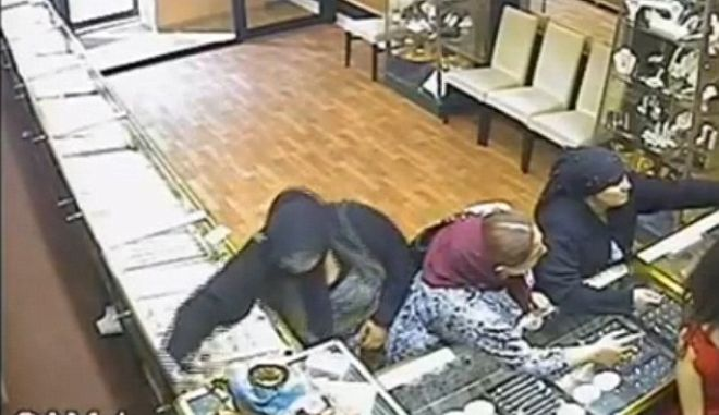 Two women have been jailed for a cunning £54,000 jewellery theft in Leicester's Golden Mile.   A CCTV camera captured the moment quick-fingered Saina Sava deftly slipped a large tray of gold bangles into a thief's pouch built into her skirt.