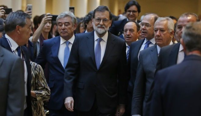 Spain's Prime Minister Mariano Rajoy arrives at the Senate in Madrid, Spain, Friday, Oct. 27, 2017. Rajoy has appealed to the country's Senate to grant special constitutional measures that would allow the central government to take control of Catalonia's autonomous powers to try to halt the region's independence bid. (AP Photo/Paul White)