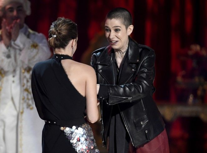 "Asia Kate Dillon, right, presents the award for best actor in a movie to Emma Watson for her role in ""Beauty and the Beast"" at the MTV Movie and TV Awards at the Shrine Auditorium on Sunday, May 7, 2017, in Los Angeles. (Photo by Chris Pizzello/Invision/AP)"