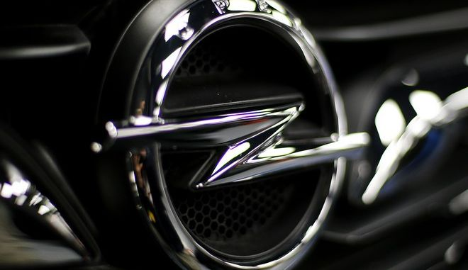 An Opel logo at a car is seen in Ruesselsheim, Germany, Thursday, Nov. 9, 2017. (AP Photo/Michael Probst)
