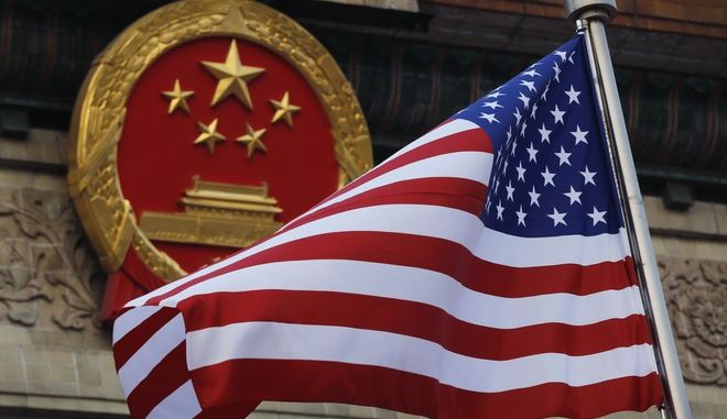 """FILE - In this Nov. 9, 2017 file photo, an American flag is flown next to the Chinese national emblem during a welcome ceremony for visiting U.S. President Donald Trump outside the Great Hall of the People in Beijing. China has criticized a U.S. government report that portrays Beijing as a potential nuclear adversary and called on Washington to honor its commitments to reduce its own arsenal. The Defense Ministry on Sunday, Feb. 4, 2018,  said China's military activities are defensive and its nuclear forces are the """"minimum level"""" required for its security. A ministry statement expressed hope the United States will """"abandon a Cold War mentality"""" and """"shoulder its special and prior responsibility for its own nuclear disarmament."""" (AP Photo/Andy Wong, File)"""