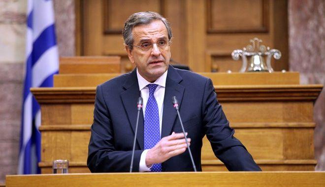 Ο πρόεδρος της Νέας Δημοκρατίας και πρωθυπουργός, Αντώνης Σαμαράς, στην Κοινοβουλευτική Ομάδα του κόμματος στην αίθουσα Γερουσίας της Βουλής, την Πέμπτη 11 Δεκεμβρίου 2014. ΑΝΤ. ΣΑΜΑΡΑ ΣΤΗΝ Κ.Ο. ΤΗΣ ΝΔ (EUROKINISSI/ΓΙΑΝΝΗΣ ΠΑΝΑΓΟΠΟΥΛΟΣ)