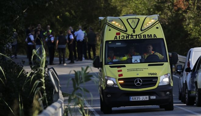 An ambulance leaves the scene of a police operation on a road near Subirats, Spain, Monday, Aug. 21, 2017. A police operation was underway Monday in an area west of Barcelona, and a Spanish newspaper reports that the fugitive in the city's van attack has been captured. Regional police said officers shot a man wearing a possible explosives belt in Subirats, a small town 45 kilometers (28 miles) west of Barcelona. (AP Photo/Emilio Morenatti)