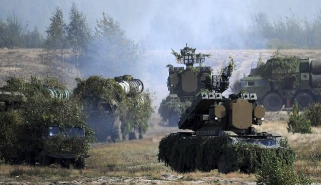 Belarusian army OSA-AKM surface-to-air missile launchers and S-300 antiaircraft systems move during military exercises, near the Volka village, 200 kilometers (125 miles) south-west of Minsk, Belarus, Tuesday, Sept. 19, 2017. The Zapad (West) 2017 military drills held jointly by Russian and Belarusian militaries at several firing ranges in both countries have rattled Russia's neigbors. (Sergei Gapon/Pool Photo via AP)