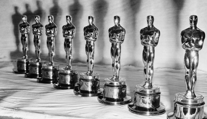 All shiny and new, these Oscars stand ready for the big Hollywood day -- the presentation of the 22nd annual Academy Awards on March 9, 1950.   The construction of an Oscar  takes about 10 different steps.   First it's made in plaster.    This provides a mold, into which the bronze is poured. Then it's scraped, field, buffed, plated, rouged, lacquered and fitted with a plastic base. (AP Photo)