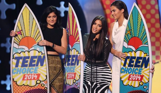 Kylie Jenner, and from left, Kim Kardashian and Kendall Jenner accept the award for choice reality show for Keeping Up with the Kardashians at the Teen Choice Awards at the Shrine Auditorium on Sunday, Aug. 10, 2014, in Los Angeles. (Photo by Matt Sayles/Invision/AP)