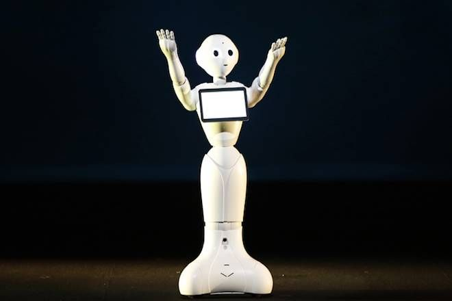 SoftBank Corp. unveils human-like robots named 'pepper' at the company's news conference in Urayasu, east of Tokyo June 5, 2014. Japan's SoftBank Corp said on Thursday it will start selling human-like robots for personal use by February, expanding into a sector seen key to addressing labour shortages in one of the world's fastest ageing societies. The robots, which the mobile phone and Internet conglomerate envisions serving as baby-sitters, nurses, emergency medical workers or even party companions, will sell for 198,000 yen ($1,900) and are capable of learning and expressing emotions, Softbank CEO Masayoshi Son told a news conference. REUTERS/Issei Kato (JAPAN - Tags: SCIENCE TECHNOLOGY BUSINESS TELECOMS SOCIETY) - RTR3SA85