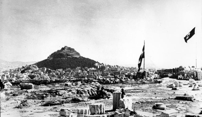 The Nazi flag with its swastika symbol, right, flies beside the flag of Greece on the Acropolis in Athens on May 27, 1941 during World War II.  The conquering German forces planted their flag amid the ancient ruins on April 28.  (AP Photo)