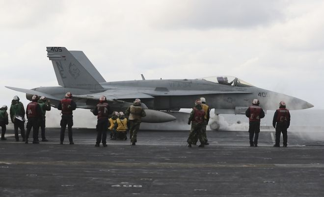An F/A-18 fighter prepares to take off from the deck of the Nimitz-class aircraft carrier USS Carl Vinson during the annual joint military exercise called Foal Eagle between South Korea and the United States at an unidentified location in the international waters, east of the Korean Peninsula, Tuesday, March 14, 2017. (AP Photo/Lee Jin-man)
