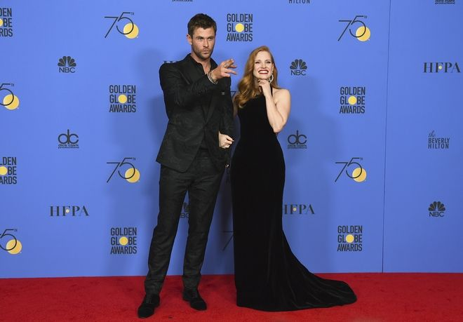 Chris Hemsworth, left, and Jessica Chastain pose in the press room at the 75th annual Golden Globe Awards at the Beverly Hilton Hotel on Sunday, Jan. 7, 2018, in Beverly Hills, Calif. (Photo by Jordan Strauss/Invision/AP)