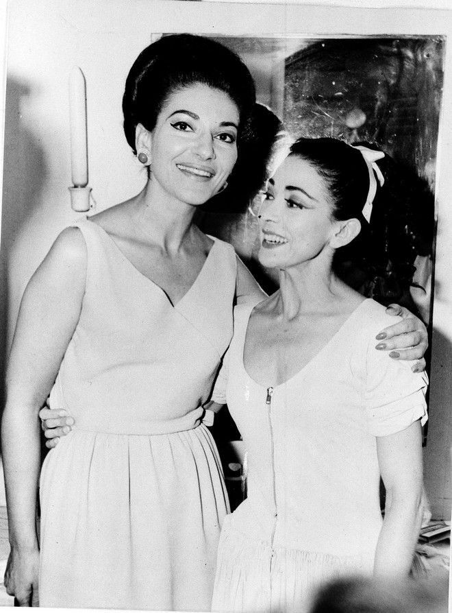 Opera singer Maria Callas, left, visits prima ballerina Margot Fonteyn after a royal ballet performance, June 1966, at the Herod Atticus Theater in Athens, Greece.  (AP Photo)
