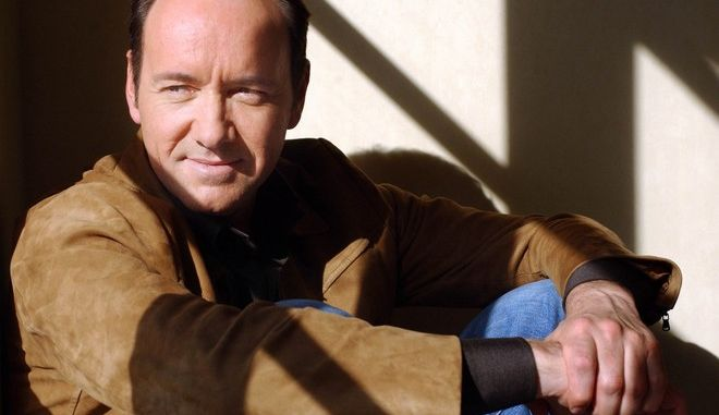 "Actor Kevin Spacey poses at the Four Seasons Hotel in Beverly Hills, Calif., Nov. 16, 2004. Spacey both directs and stars in the new biographical film, ""Beyond the Sea,"" about singer and teen idol Bobby Darin. (AP Photo/Ann Johansson)"