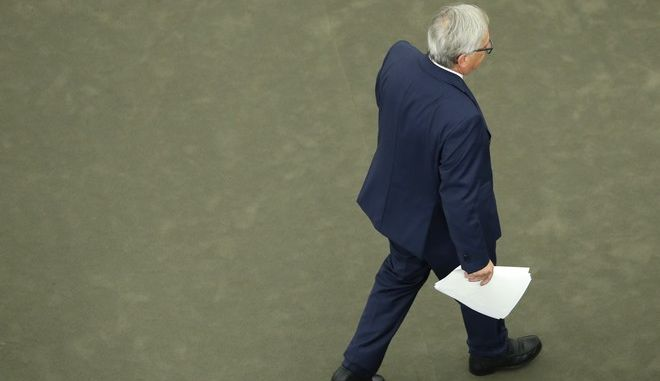 "European Commission President Jean-Claude Juncker walks off the dais after addressing the members of the European Parliament in Strasbourg, eastern France, to outline his reform plans for the European Union in the so-called State of the Union debate, Wednesday, Sept. 13, 2017. Juncker said the European Union is ""bouncing back"" after a tough decade that's seen much of the 28-country mired in an economic crisis and Britain vote to leave. (AP Photo/Jean-Francois Badias)"