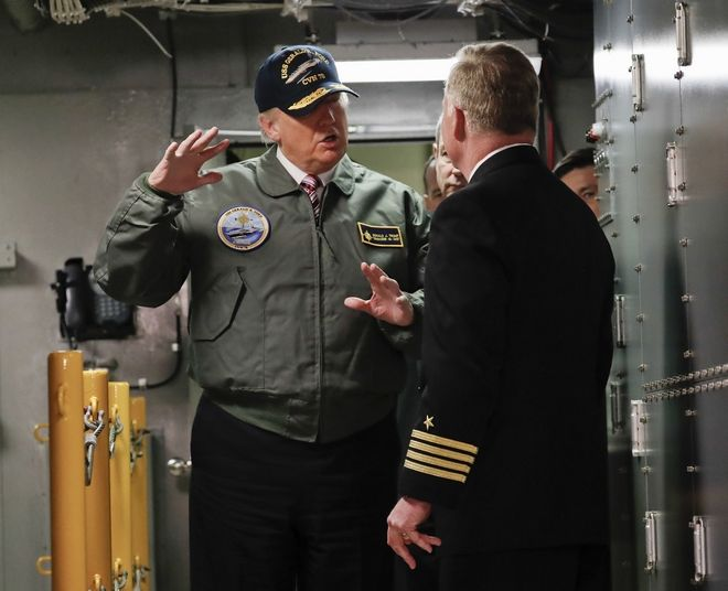 "President Donald Trump talks with Capt. Richard ""Rick"" McCormack during a tour of the nuclear aircraft carrier Gerald R. Ford, Thursday, March 2, 2017, at Newport News Shipbuilding in Newport News, Va. Trump traveled to Virginia to meet with sailors and shipbuilders on aircraft carrier which is scheduled to be commissioned this year after cost overruns and delays. (AP Photo/Pablo Martinez Monsivais)"