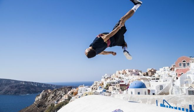 Who will flip, jump, spin and drop their way to the Red Bull Art of Motion final this weekend? Here's a taste of what's in store against the majestic backdrop of the white-washed clifftop houses of Oia on Santorini. Dimitris Kyrsanidis performs during the preshoot for the Red Bull Art Of Motion on Santorini island, Greece on October 5, 2017 // Samo Vidic/Red Bull Content Pool via AP Images  // For more content, pictures and videos like this please go to http://www.redbullcontentpool.com