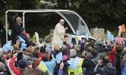 Pope Francis waves as he arrives at the Knock Shrine, in Knock, Ireland, Sunday, Aug. 26, 2018. Pope Francis is on a two-day visit to Ireland. (Niall Carson/PA via AP)