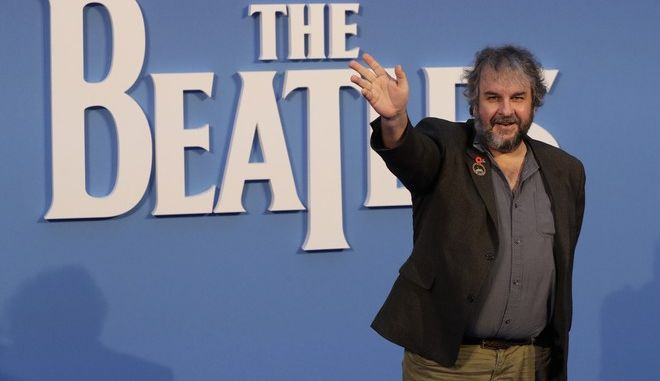 Film director Peter Jackson poses for photographers upon arrival at the World premiere of the Beatles movie, Ron Howard's 'Eight days a week-the touring years' in London, Thursday, Sept. 15, 2016. (AP Photo/Kirsty Wigglesworth)